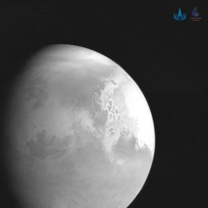 Segment of sphere lower left - Mars in grayscale with features visible.