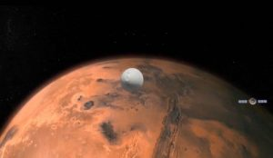 white spacecraft center in front of top part of red planet.