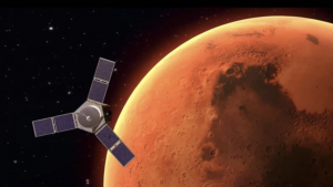 Spacecraft with three solar panel wings above close, red Mars.