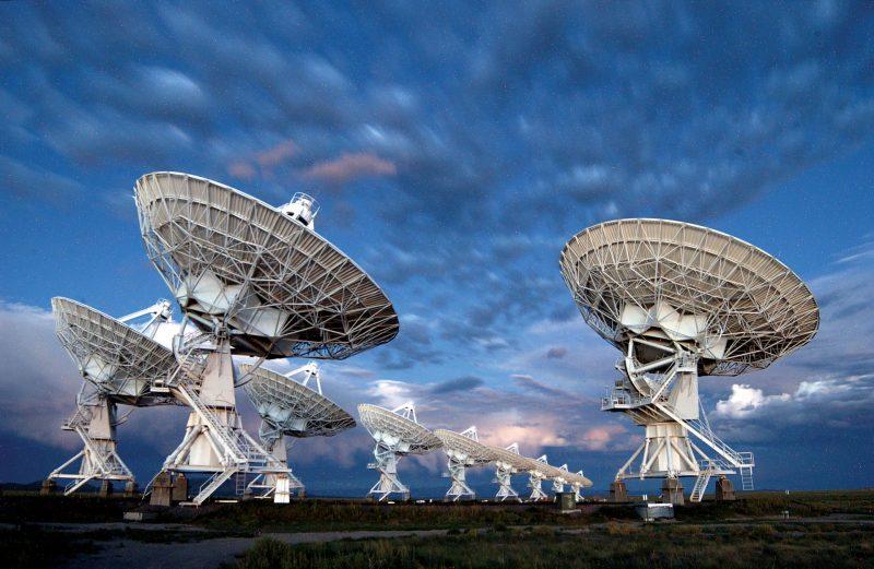 Multiple, large, dish-type radio telescopes.