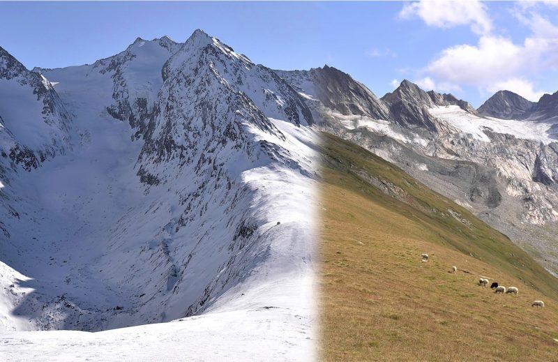 Mountain scene, half snow-covered, half grassy.