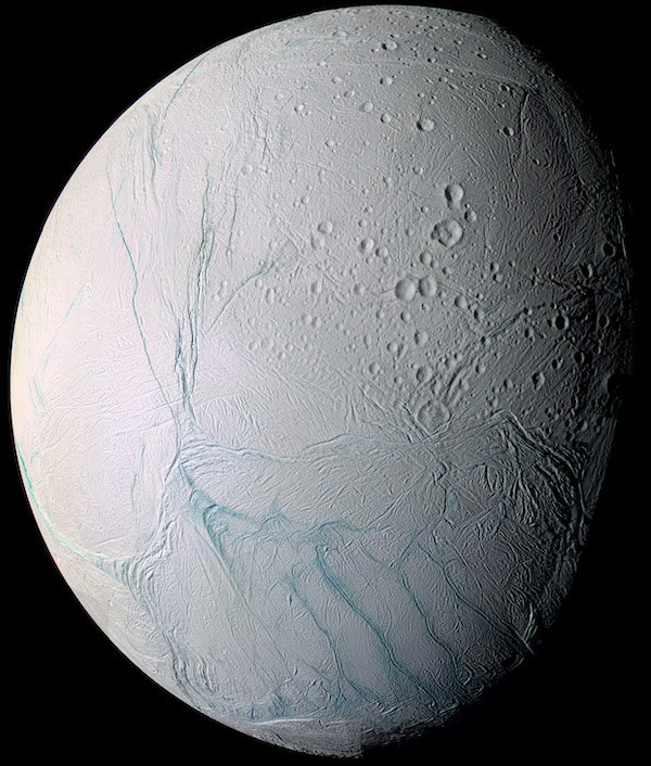 White ball with veiny blue lines and small craters on a black background.