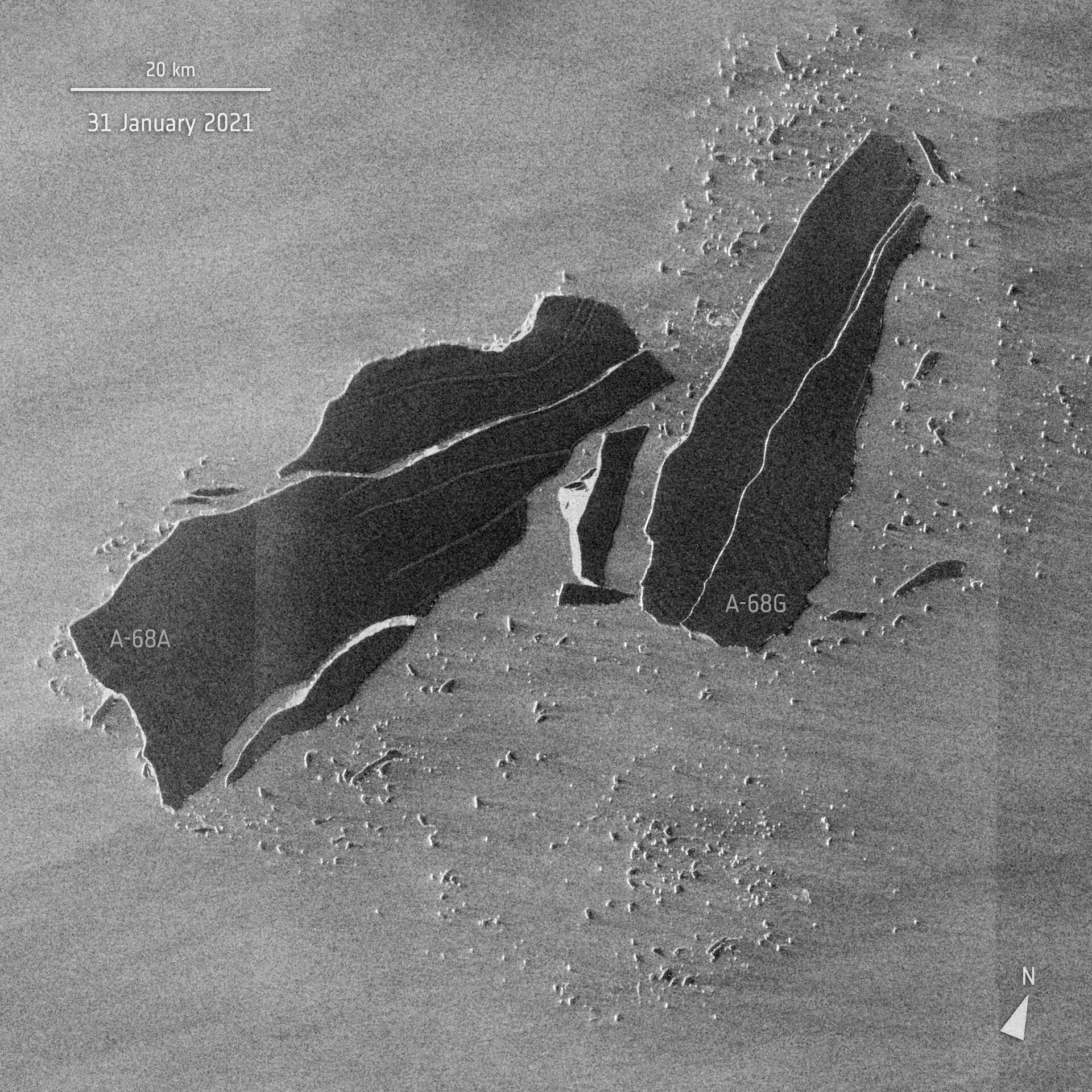 Two irregular dark gray rectangles on a lighter gray background.