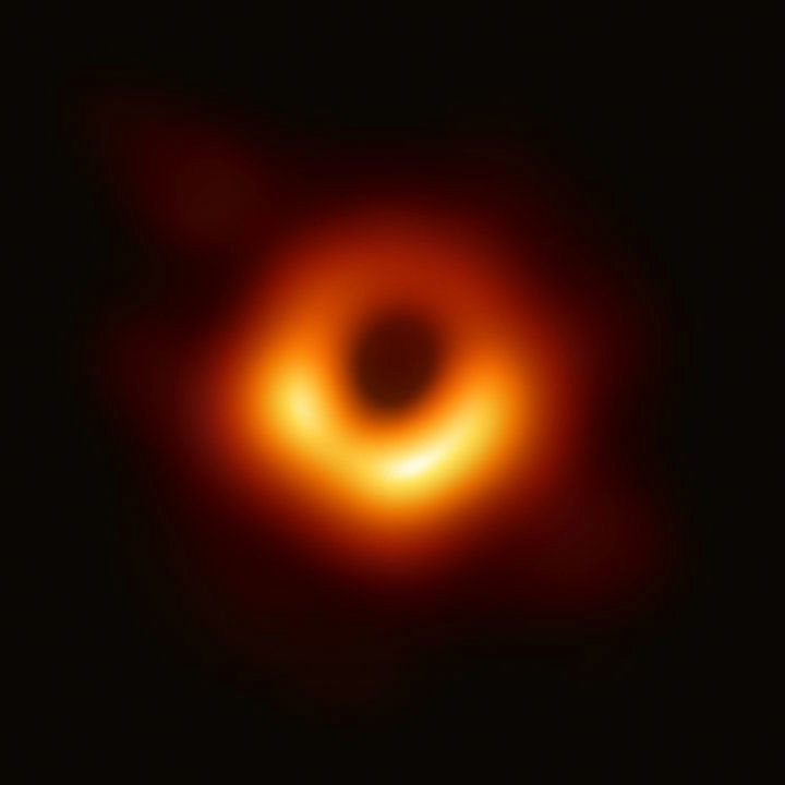 An orange ball of light with a black ball at its center giving a donut effect.
