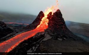 Red lava pouring from a volcanic crater.