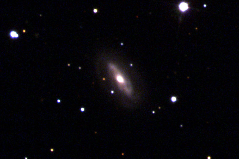 Black background with an elliptical shape in the centre, white dots (stars) around.
