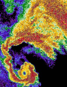 Multicolor radar image of hook curving left to right.