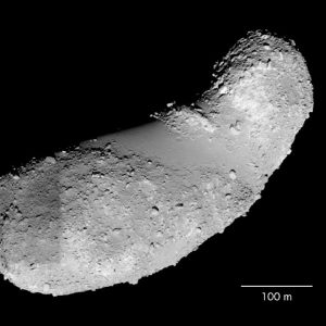 Elongated beanshaped grey and bumpy rock on black background with 100-meter line for scale.