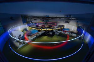 Long-exposure shows arcing lights of spinning centrifuge.