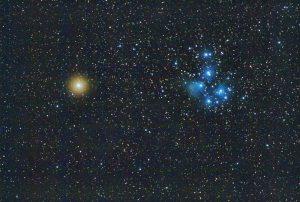 Bright Mars in pale orange beside bluish stars.
