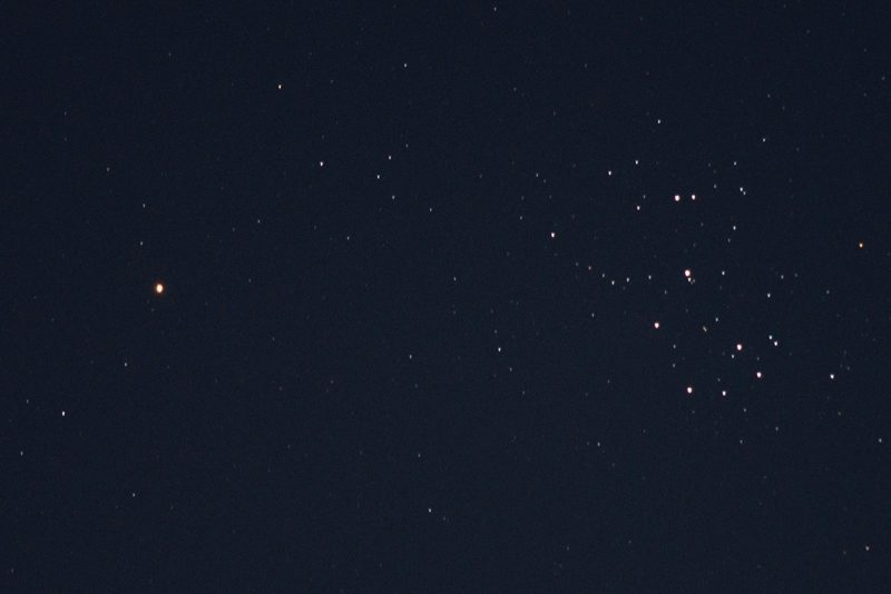 Red dot of Mars left, star cluster right.