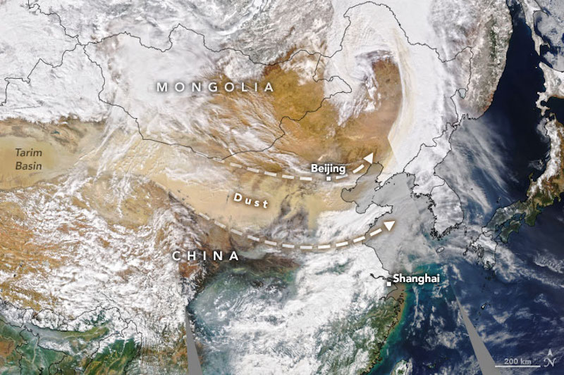 Satellite view of wide streak of tan dust over central and eastern China.