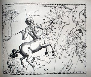 Antique etching of a centaur holding a spear with scattered stars in black on white.