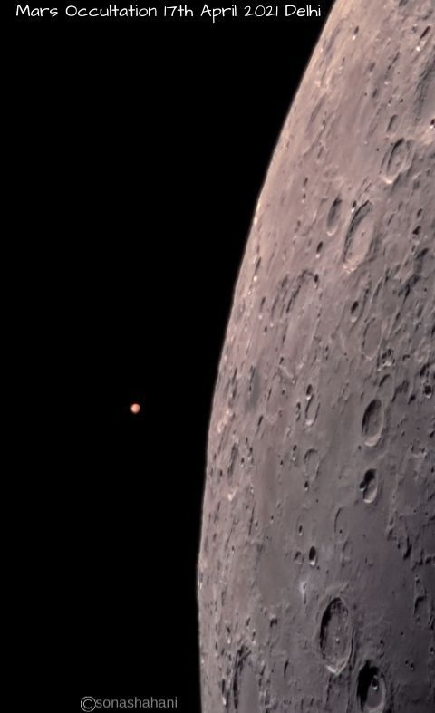 Lit side of moon with small circle of Mars nearby.