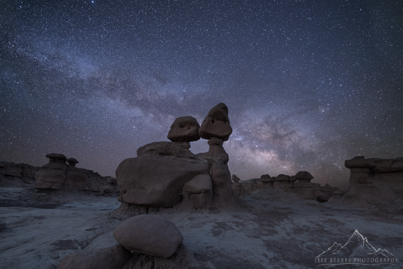 Hoodoo rocks in front of Milky Way star clouds.