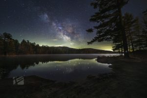 Starry cloud over lake with fog.