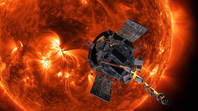 Spacecraft with large, active, orange and yellow sun in the background.