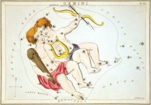 Antique color etching of twin boys with lyre, club and bow in a star field.
