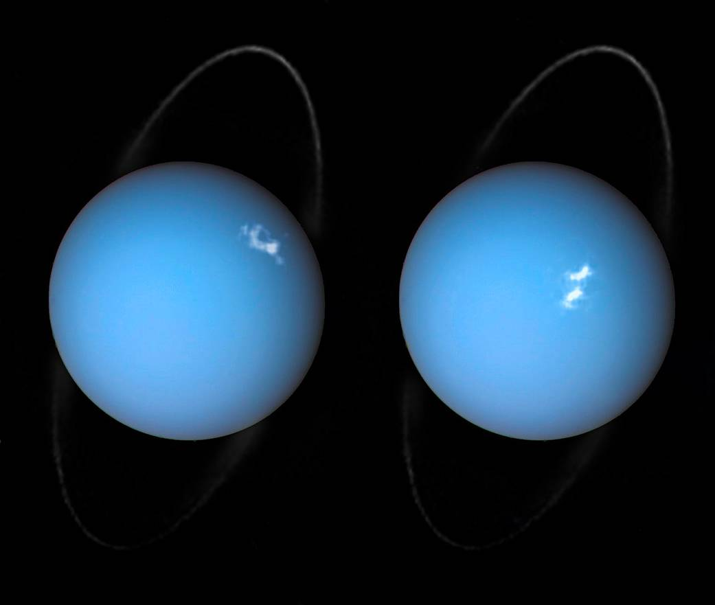 Two bluish planets with white spots and thin rings on black background.