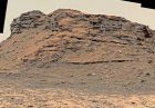 Rocky outcrop with horizontal layers.