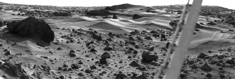 Sand dunes and rocks in black and white.