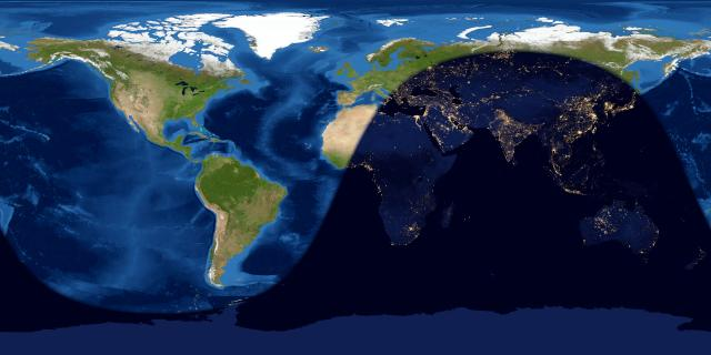 Rolled-out map of world with shadow over part of Europe, most of Africa and Asia.