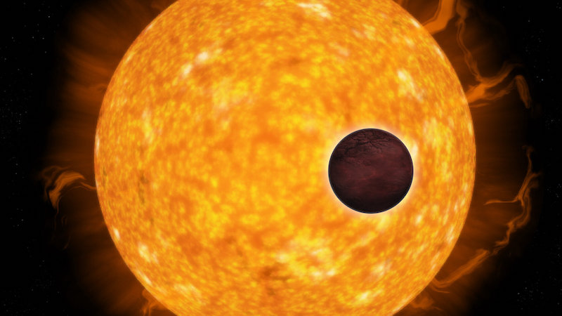 Dark planet in front of its much larger bright star.