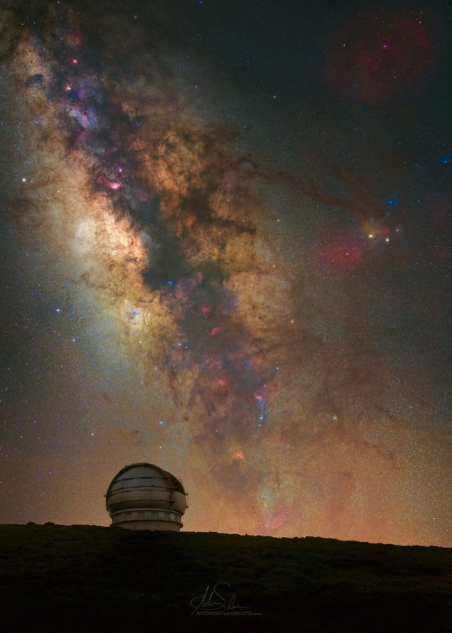 Telescope dome on hill with detailed Milky Way behind.