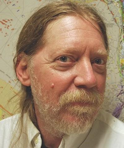 Man with long hair and beard.