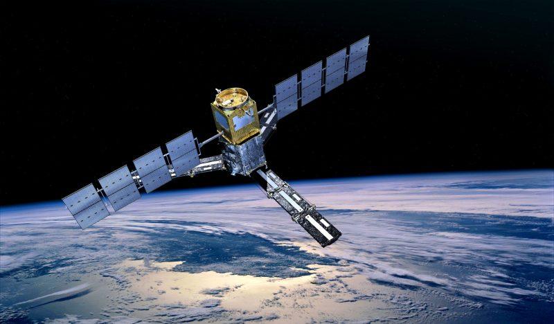 Satellite in Earth orbit above glistening white Arctic sea ice.
