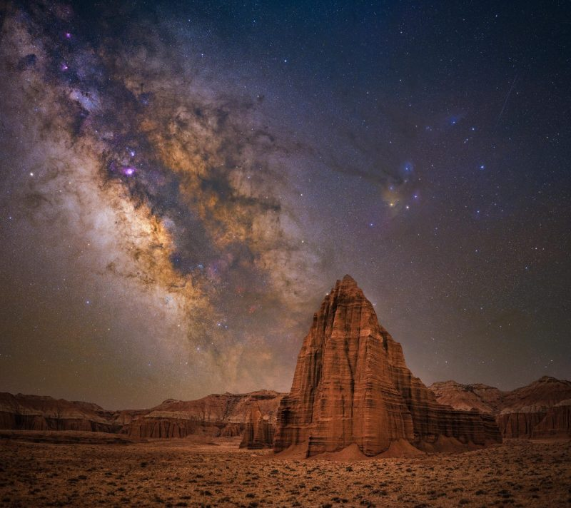 Towering, pointed red rock formation with Milky Way behind in best Milky Way photos.
