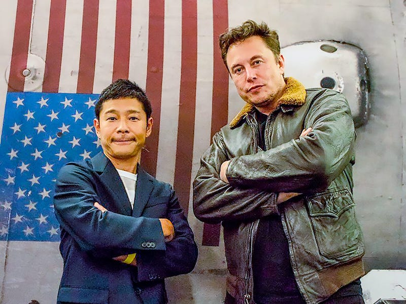 Maezawa and Musk stand side-by-side with folded arms, looking too cool to handle.