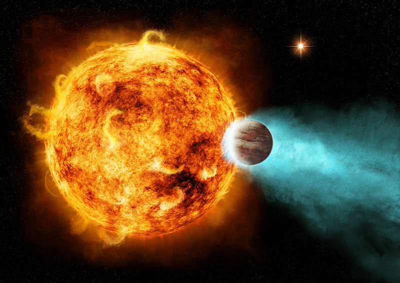 Shrinking planet with evaporating atmosphere near a blazing red star.