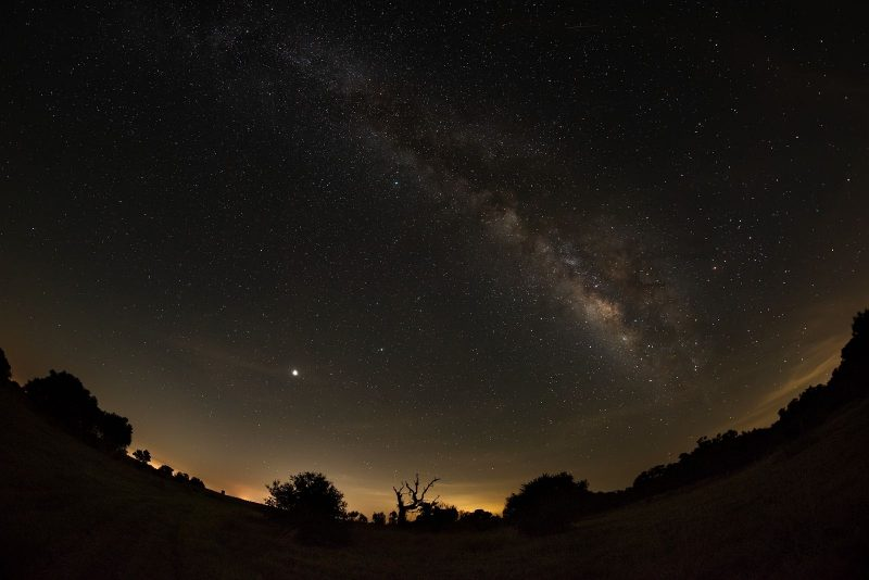 A dark sky, the Milky Way, Jupiter and Saturn.