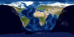 Worldwide map of day and night sides of Earth at mid-eclipse.