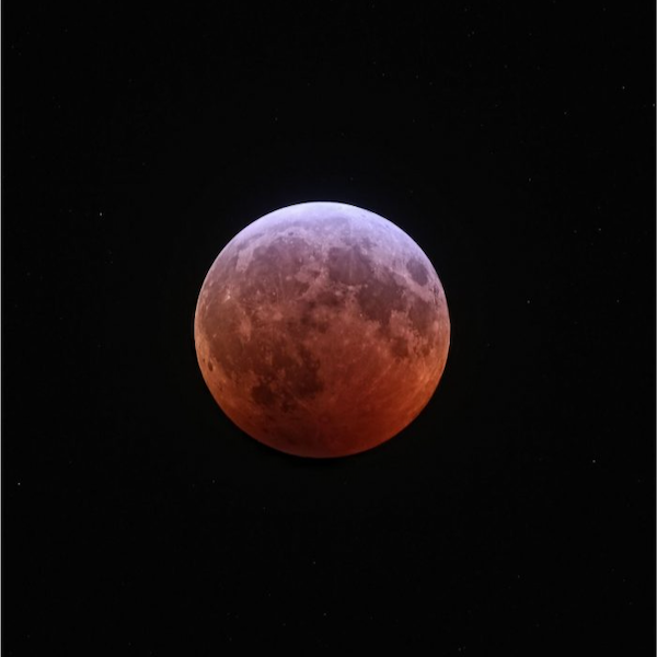 A full moon appearing coppery red in color at mid-eclipse.