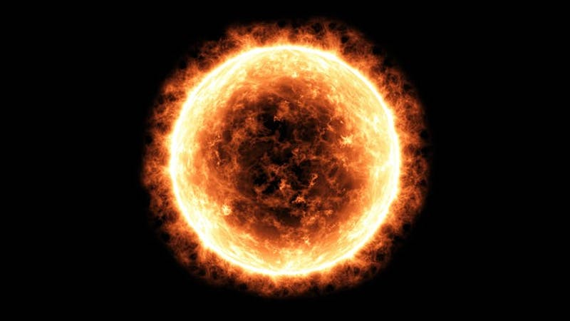 The sun, a yellowish circle, with the sun's atmosphere as a flaming edge.
