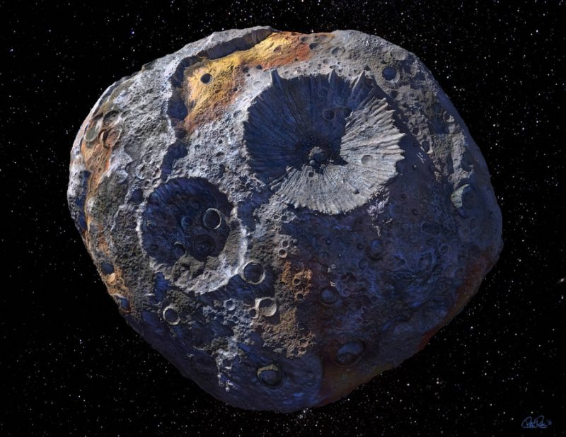 Asteroid Psyche is shown as a roundish rocky body with 2 large and many small craters.