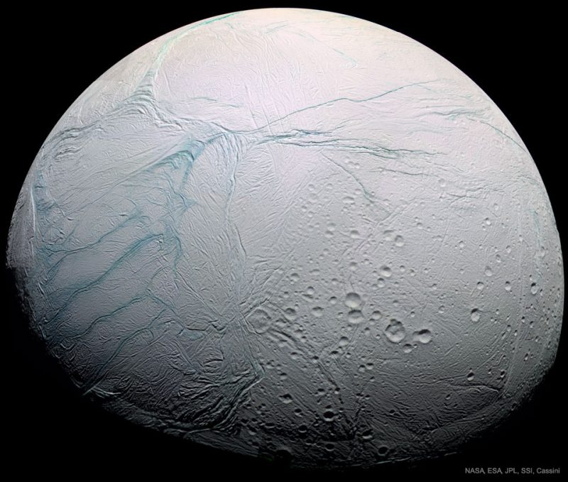 Planet-like white body with bluish cracks and craters.
