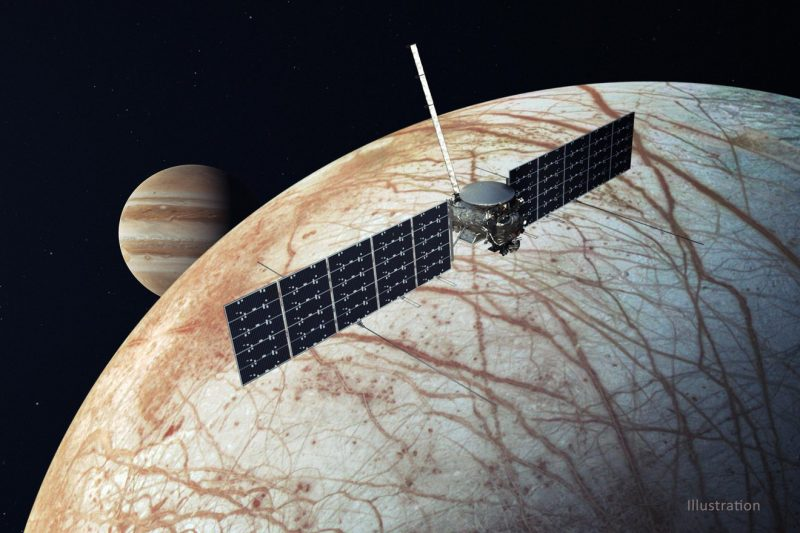 Spacecraft with wide solar panets above whitish moon with many brown cracks; banded planet in distance.