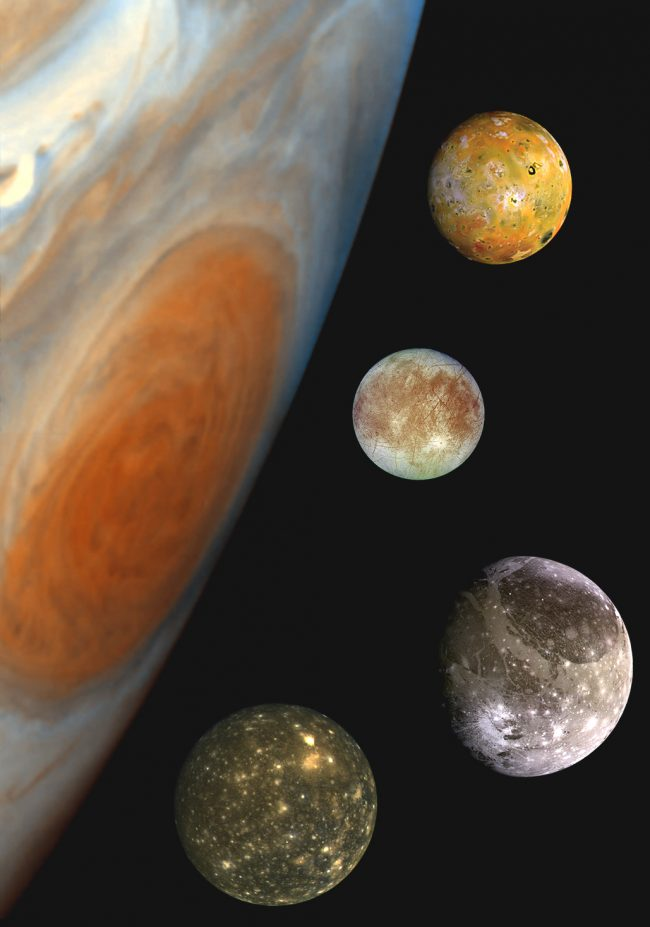 Side of Jupiter with its 4 largest moons each with different surface patterns.
