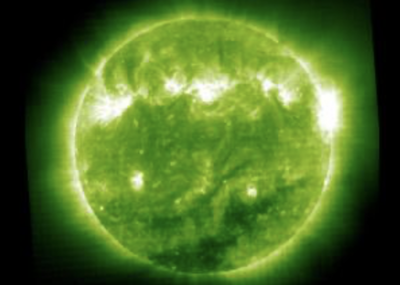Not Zubeneschamali, but a round sun, showing some details, falsely colored green.