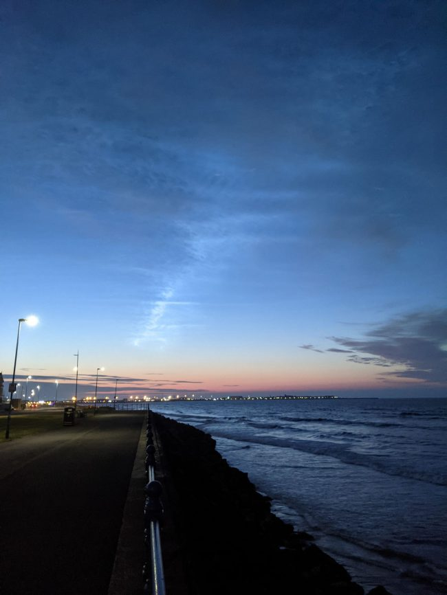 Night-shining clouds over a beach.