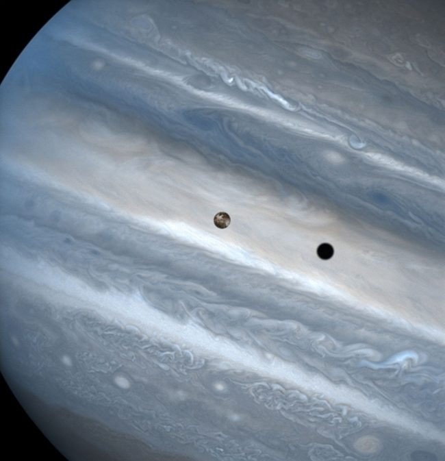 Transits of Jupiter's moons: Close-up of Jupiter. Moon with visible features and its shadow superimposed on Jupiter.