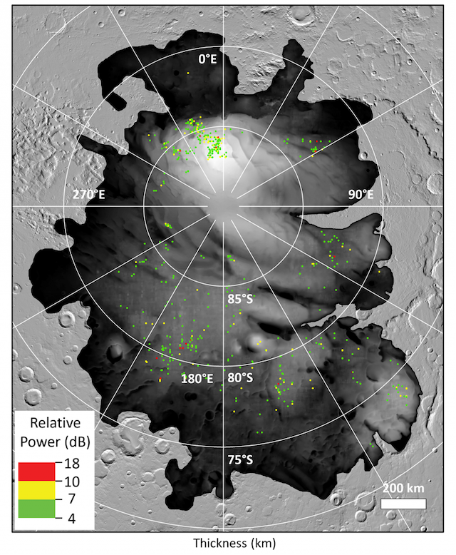 Map with large irregular dark area, colored dots and lines and circles radiating outward.