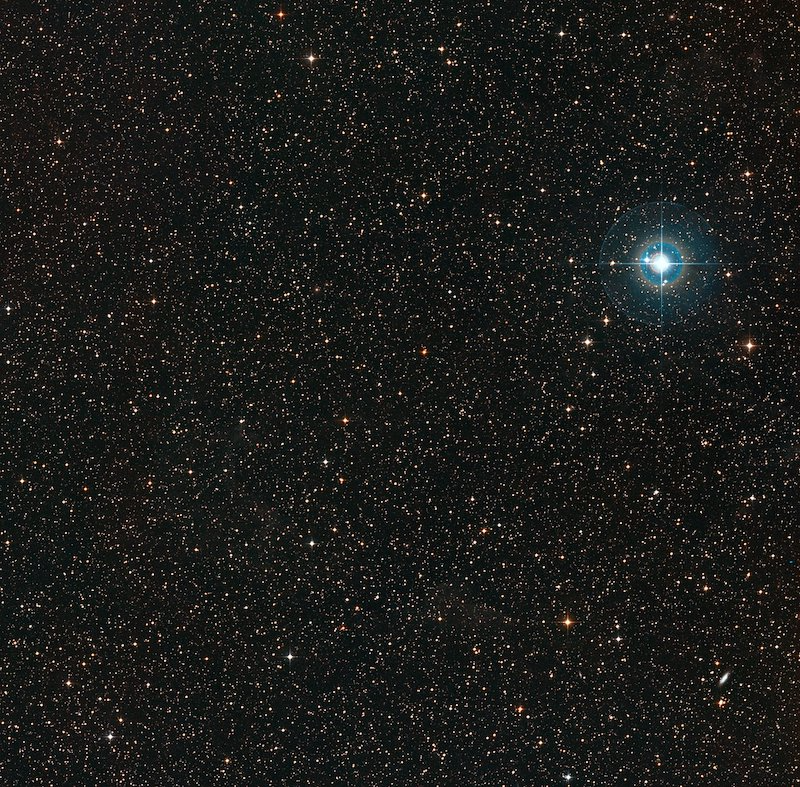 Bright star in upper right, with thousands of more distant stars in background.
