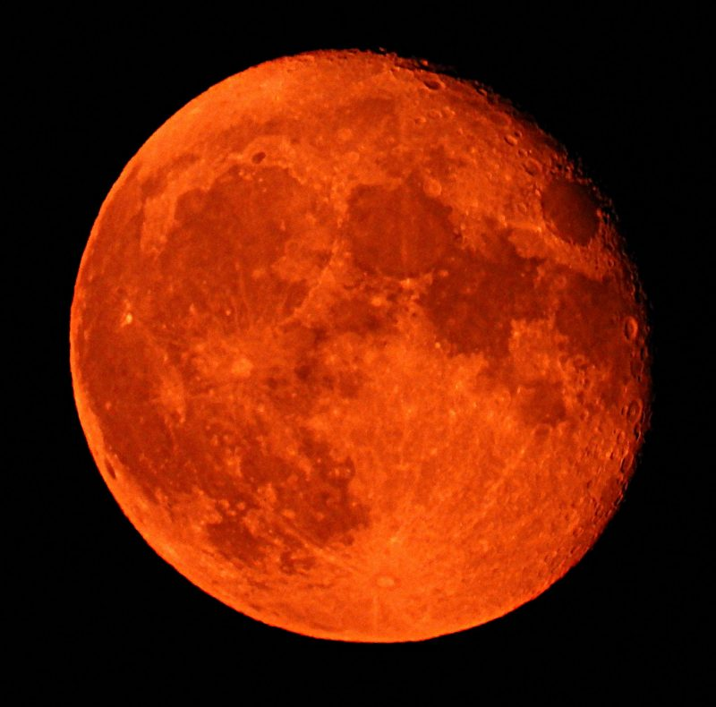 Red suns and moons: Waning moon with a reddish orange color.