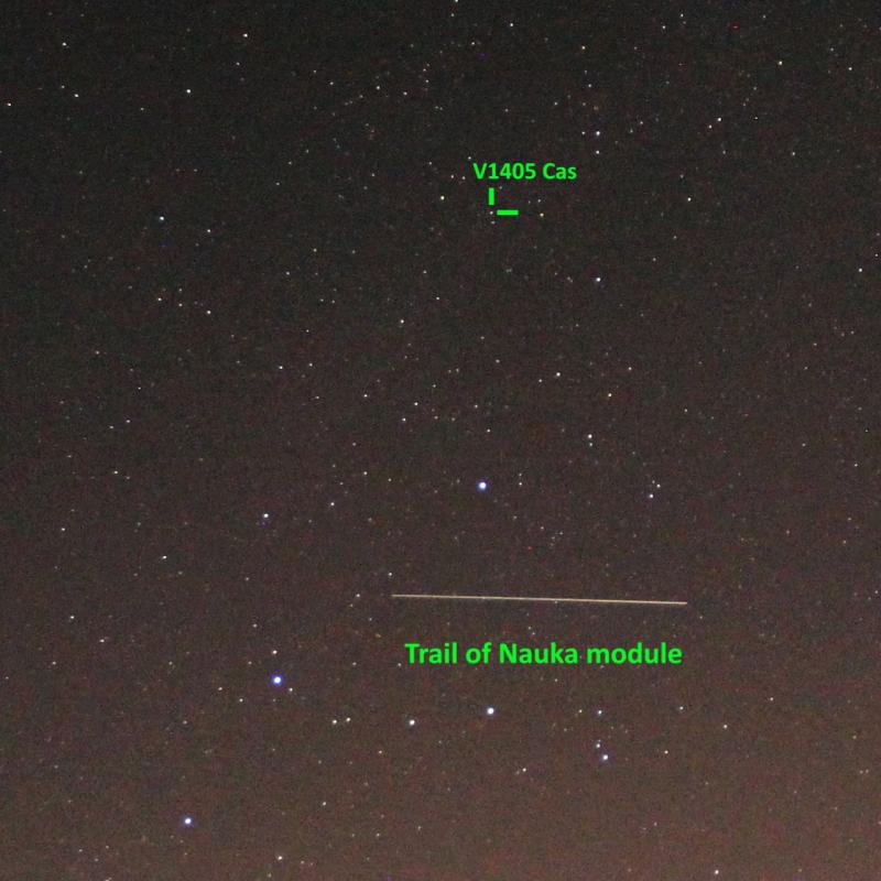 Russia's Nauka module: A star field. One object (the nova) is in brackets. The other object (the module) is a long streak.