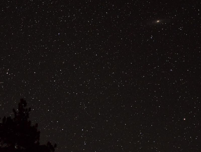 Starry sky with a fuzzy blob in the top right corner.