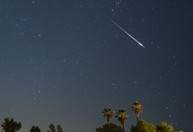 Perseid meteor from top to right side, a thin streak increasing in width toward the lower end.